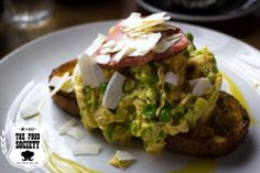 green eggs and ham, herby scrambled eggs, crushed peas, ham, salted ricotta, toast