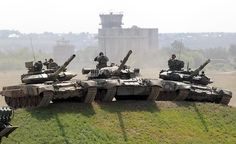 """Russian armories develop the """"T-80"""" (center) next to the """"T-90"""" (both outside)."""