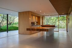 Los Faiques Dwellings by DURAN - like the cantilevered table attached to the cooking island