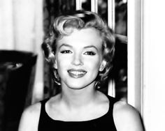 Marilyn Monroe attends a press conference for The Prince and the Showgirl at the Savoy Hotel, London, July, 1956