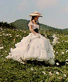 "Favourite Sissi Trilogy Gowns ""The white & floral dress with big black & floral belf worn as she collect flowers in Bad Ischl "" Romy Schneider, Angel Aesthetic, Aesthetic Vintage, Film Passion, Vintage Dresses, 1800s Dresses, Long Dresses, Vintage Princess, Princess Aesthetic"
