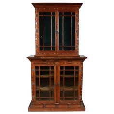 English Renaissance Revival Two-Part Bookcase | From a unique collection of antique and modern bookcases at https://www.1stdibs.com/furniture/storage-case-pieces/bookcases/