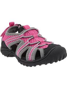 7e40078542027 Water-resistant shell with eyelets at sides for breathability. Bungee cords  across foot; secure-close strap in back. Textured sole for traction.