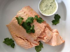 Poached Salmon with Cilantro Sauce -- An extremely easy, foolproof method for poaching salmon, and several choices of sauces to go with.  From Katie Workman/themom100.com