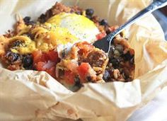 Steak and Eggs Foil Packs  Indulge in the wild with this incredible foil packet recipe. As easy as they are delicious, and perfect for tossing on the campfire!      1 packet Old El Paso Tortilla Stuffers--Carne Asada Steak Flavor      2  eggs      1/2 cup sharp cheddar cheese, grated      heavy-duty foil    one large sheet of foil, and the remaining on a second large sheet of foil.