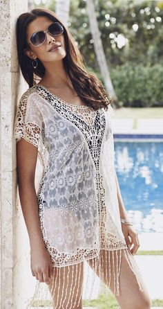 The lace on this swimdress cover up gives it a romantic, feminine look and feel. Fringe adds a playful touch.