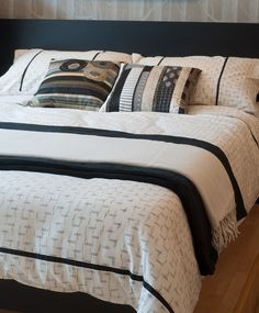 Natural Icat duvet cover, handwoven in a village near Hyderabad in South India. The simple black on cream print is a traditional pattern with a modern monochrome sensibility. Exclusive to Natural Bed Company - www.naturalbedcompany.co.uk. Feel free to pin!