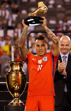 #COPA2016 #COPA100 Eduardo Vargas of Chile holds up the Golden Boot Award following the championship match between Argentina and Chile at MetLife Stadium as part of...