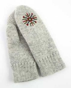 Felted wool mittens with embroidered symbol