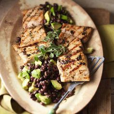 This Mahi Mahi with Black Bean & Avocado Relish is a delicious way to get healthy fish into your diet. Black beans, avocado, and cilantro combine for an easy, make-ahead relish. More avocado recipes: guide tips cooking Avocado Recipes, Fish Recipes, Seafood Recipes, Great Recipes, Cooking Recipes, Favorite Recipes, Healthy Recipes, Recipies, Party Recipes