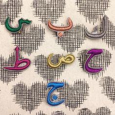 Zari thread work mini charms all online now at www.ecruonline.com under 'accessories' #ecru #charm #letter #accessories #zari #threadwork #embroidery #calligraphy #Arabic #brooch