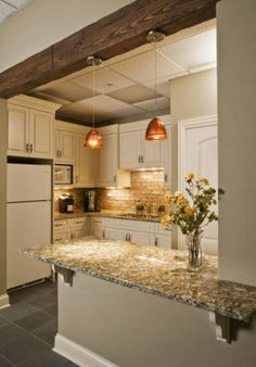 Brick backsplash and low ceiling would look good with tin!