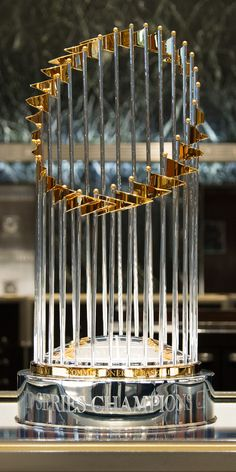 The Major League Baseball World Series trophy features 30 flags, one for each Major League team, with latitude and longitude lines symbolizing the world.