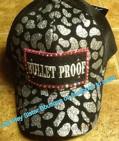 Bullet Proof black and silver cheetah trucker hat, low profile, with pony tail...Hey Sister Boutique hat made with swarvorski crystals several to choose from check us out on facebook. $30