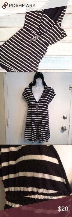 """Old Navy Striped Hooded Swimsuit Coverup Old Navy black and white striped swimsuit coverup tunic dress with hood. Does have some piling. Size small. Measures 18""""' flat from armpit to armpit, 13.5"""" flat at waist, and 31"""" shoulder to hem. No modeling. Smoke free home. I do discount bundles. Old Navy Swim Coverups"""