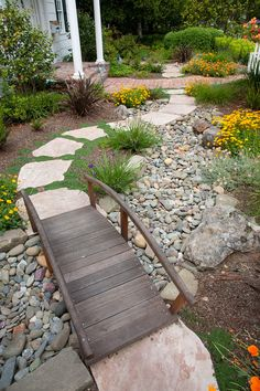 Beautiful, water-saving dry creek bed in the front yard. I want a bridge designed somehow/somewhere in my flower bed