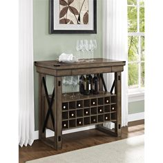 Happy hour can be enjoyed at home any day of the week with the Altra Wildwood Wood Rustic Grey Veneer Bar Cabinet. This mini bar can hold 24 wine bottles and has an open shelf to store glassware, bottles or serving accessories.