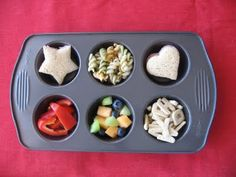 Ham sandwiches, pasta salad, fruit salad, red bell peppers and alphabet crackers
