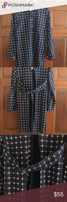 Long button-up, open in the back.  VERY unique HARVEY (Australian brand) long button up.  Buttons only half way in front and open in the back.  Very unique!!!  Navy blue and white.  Tags attached, never worn. HARVEY Tops Button Down Shirts