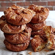 """To pastry chef Jean-Yves Charon, a kouign amann tastes like home. From his native Brittany, this classic Breton """"butter cake"""" relies on layers of handmade puff pastry dough to create a decadent treat with a sweet, buttery center and … Galaxy Desserts, Köstliche Desserts, Delicious Desserts, Yummy Food, Fancy Desserts, Williams Sonoma, Puff Pastry Dough, Bread And Pastries, Gourmet Recipes"""