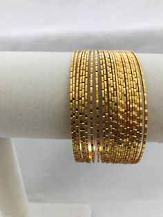 Plain gold glitter set of twenty four bangles Handmade jewelry Silver plated jewelry * * * Actual product color may vary slightly due to screen resolution and digital photography. Gold Chain Design, Gold Bangles Design, Gold Jewellery Design, Gold Jewelry, Plain Gold Bangles, Silver Jewellery Indian, Gold Fashion, Digital Photography, Jewelry Photography