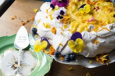 Dessert! Pavlova with lemon curd topped with edible flowers.