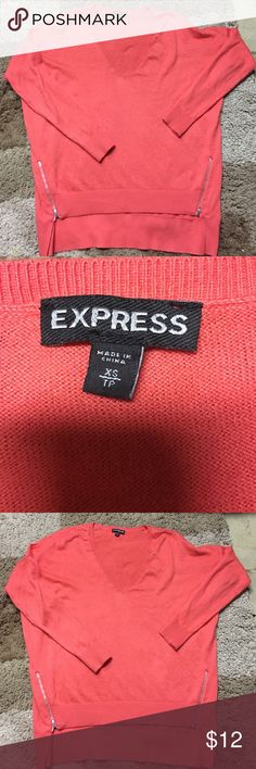 Express sweater with zippers Worn very lightly. Super cute coral color. Two zippers on bottom. Fits loosely Express Sweaters