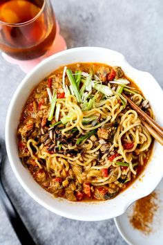 Vegan tantanmen recipe - Ditch the pork and make yourself and healthier bowl of tantanmen today! Earthy mushrooms and sweet red bell peppers dance in a spicy, savory and nutty broth packed with umami. This is one dish you will want to add to your meatless meal rotation! Ready in 25 minutes from start to finish. #ramen #recipes #vegan #vegetarian | pickledplum.com