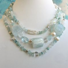 Aquamarine, freshwater pearl and quartz crystal triple strand necklace with gold vermeil clasp.