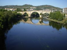 "The ""Ponte Vella,"" or old Roman bridge that spans the Mino River, is a symbol of the city of Ourense."