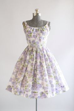 RESERVED RESERVED RESERVED  This 1950s Jerry Gilden dress features a gorgeous floral print in shades of purple and green. Sleeveless. Shelf