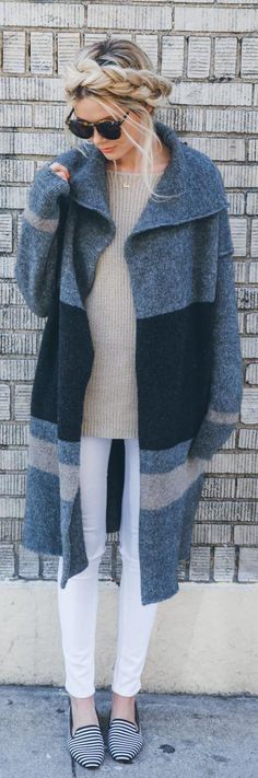 We love the stripes in this chic minimalist outfit! Long cozy sweaters can add a statement to a simple wardrobe.