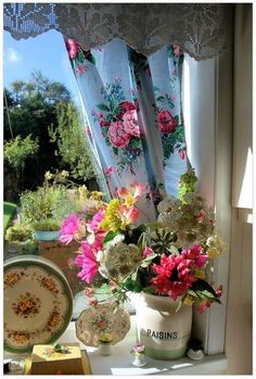 Love the fabric the curtains are made of -french country look!