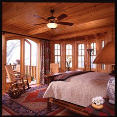 Log cabin bedroom. Love the open windows and balcony. Probably change the interior furniture, but overall it looks cozy