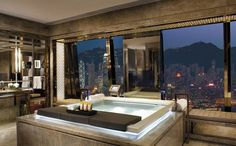 """The world's highest hotel, the Ritz-Carlton Hong Kong's penthouse suite of course offers an impressive view of the city - if smog doesn't encase the building"""