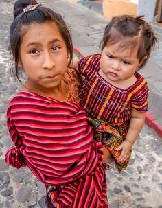 Guatemalan girl taking care of her sister. @ Antigua Guatemal