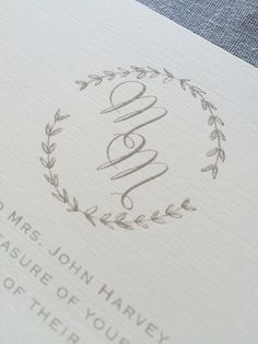 Drawn Laurel wedding invitation featuring calligraphy initials and hand-drawn laurel wreath, in gray