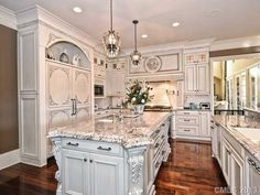 Fancy kitchen. Marble counter tops and elegant fridge.