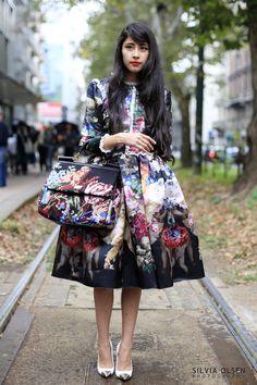 This is a photo of fashion blogger Denni Elias  at a Dolce & Gabbana fashion show in Milan.