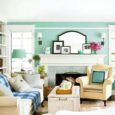 Coastal cottage decor. Great couch, coffee table and chair placement, plus the accessories.