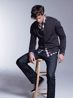 collared shirt, v-neck button-up sweater, dark jeans, and fashionable sneakers for a casual, yet put-together look.