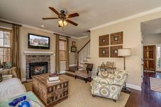 Traditional Living Room with stone fireplace, Ceiling fan, High ceiling, Carpet, Hardwood floors, Sunken living room