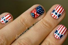 This retro patriotic nail design by Dressed Up Nails is perfect for your 4th of July. Check out our 15 Patriotic 4th of July Nails here! #holidaynails #nails #nailart