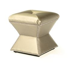 Gold faux hide ottoman with nailhead trim. An industry leader in home furnishings, this manufacturer is known for the highest quality products.