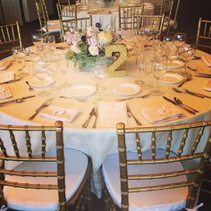 Ivory & Gold Wedding. Love the custom table numbers