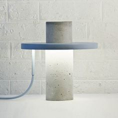 Paris based designer Alexandre Dubreuil has created the Totem Lamp. The lamp is made of solid concrete. A thin, donut-shaped lighting element sits on the Beton Design, Filigranes Design, Concrete Design, Design Studio, Design Trends, Interior Lighting, Modern Lighting, Lighting Design, Concrete Light