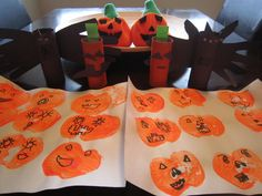 """Halloween crafts: Cut apples in half & stamp with paint for """"pumpkin"""" placemats; paint toilet rolls orange and black, trace & cut out hand prints for bat wings, paste construction paper ears & fangs for bats, eyes & mouth for pumpkins, glue on googly eyes."""