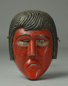 Ajitz . This vintage dance mask from Guatemala, somewhat of an enigma, was in all likelihood originally a Moro, and later repainted red to be danced as an Ajitz.