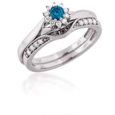 Ladies White and Treated Blue Diamond Ring in White Gold!!!  My fave flower is a daisy.... How gorgeous!!! <3