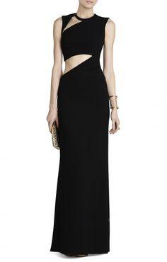 Vestido de fiesta en color negro y con cortes asim�tricos en escote y cintura de BCBG.